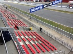 The first few fans start to populate the main straight grandstands
