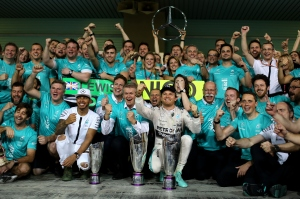ABU DHABI, UNITED ARAB EMIRATES - NOVEMBER 29: Nico Rosberg of Germany and Mercedes GP celebrates with his team, including Lewis Hamilton of Great Britain and Mercedes GP, outside the garage after winning the Abu Dhabi Formula One Grand Prix at Yas Marina Circuit on November 29, 2015 in Abu Dhabi, United Arab Emirates. (Photo by Mark Thompson/Getty Images)