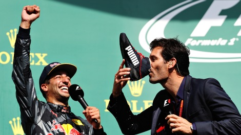 SPA, BELGIUM - AUGUST 28:  Mark Webber drinks champagne from the boot of Daniel Ricciardo of Australia and Red Bull Racing on the podium during the Formula One Grand Prix of Belgium at Circuit de Spa-Francorchamps on August 28, 2016 in Spa, Belgium  (Photo by Mark Thompson/Getty Images)